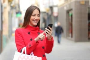 44895753 - shopper woman buying online on the smart phone in the street